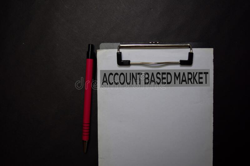 Account Based Market write on a paperwork isolated on black table stock images