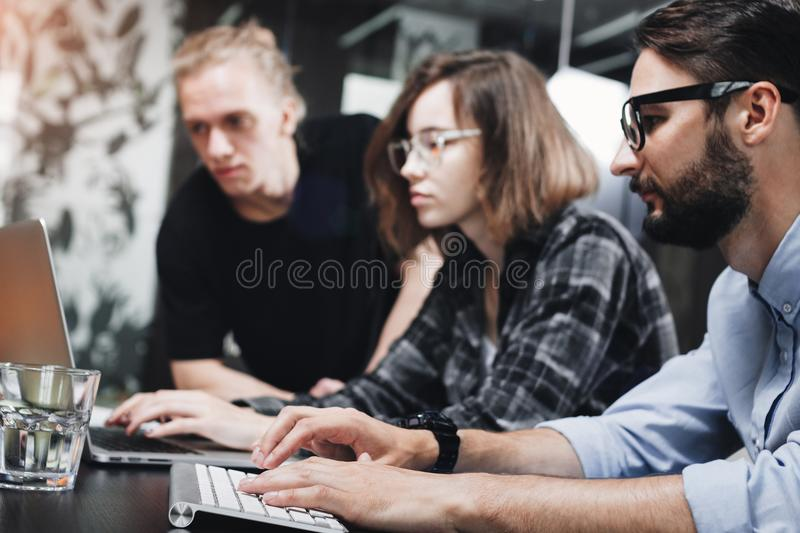 Account managers young crew works with new startup in modern loft space. Team brainstorming. Photo of creative managers crew work royalty free stock photography