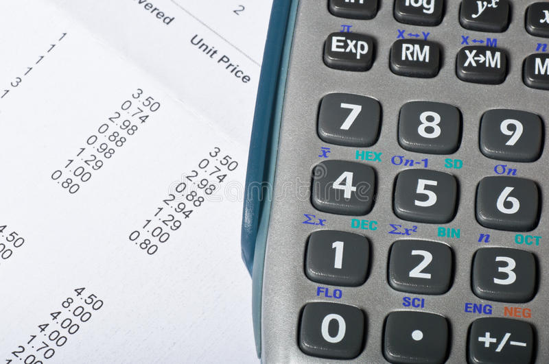Accountancy. Calculator resting on an accountants spreadsheet royalty free stock photos