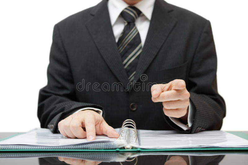 Accountant or auditor pointing to you, gives a warning stock photo