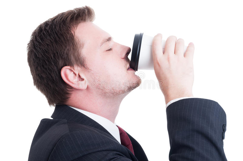 Accountant or broker drinking coffee from a paper cup stock photo