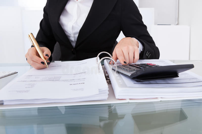 Accountant calculating tax royalty free stock photography