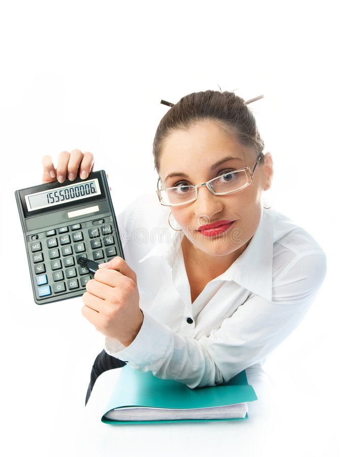 Accountant with a calculator. Young attractive accountant holding a calculator and showing us the figures royalty free stock images