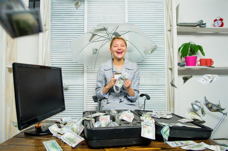 Accountant enjoy cash rain in office. Cash rain concept. Money falling as rain. Woman business lady or accountant under. Umbrella. Financial success. Accountant royalty free stock photo