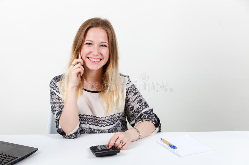 The accountant girl counts on the calculator stock photo