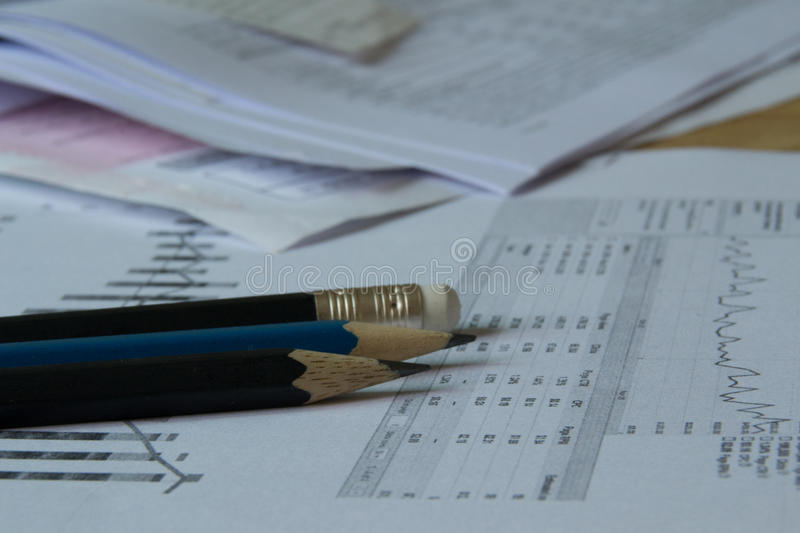 Accountant jobs. Jobs of accountant with statistics paper royalty free stock photos