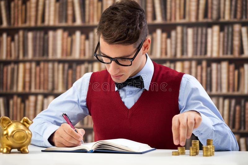 Accountant making note. And counting money royalty free stock photo