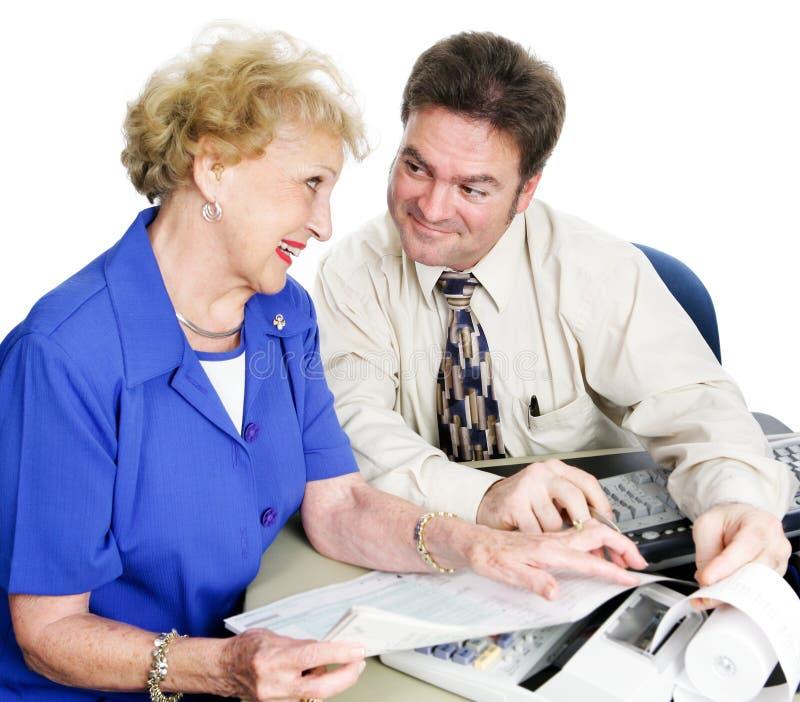 Accountant met Hogere Dame royalty-vrije stock afbeelding