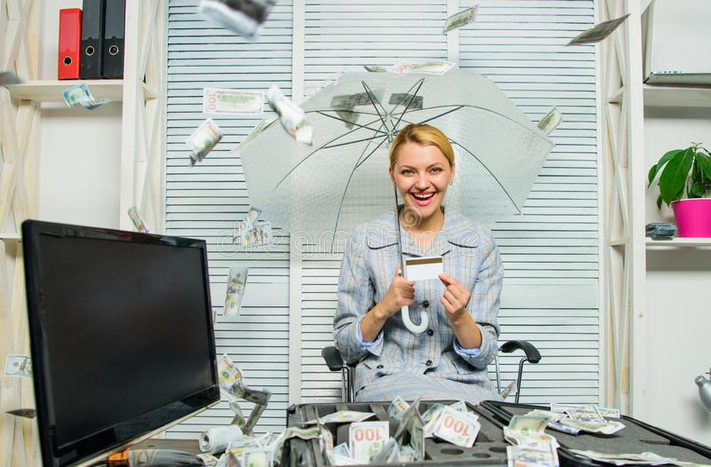 Accountant with pile money hide under umbrella. Accountant enjoy cash rain in office. Cash rain concept. Money falling. As rain. Woman business lady or royalty free stock photos