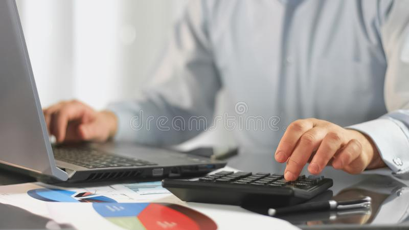 Accountant preparing report laptop, financial expert analyzing diagram document. Stock photo royalty free stock images