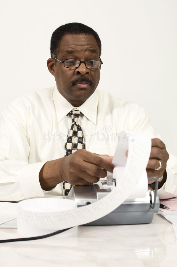 Download Accountant Reading An Adding Machine Tape Stock Photo - Image: 29661220