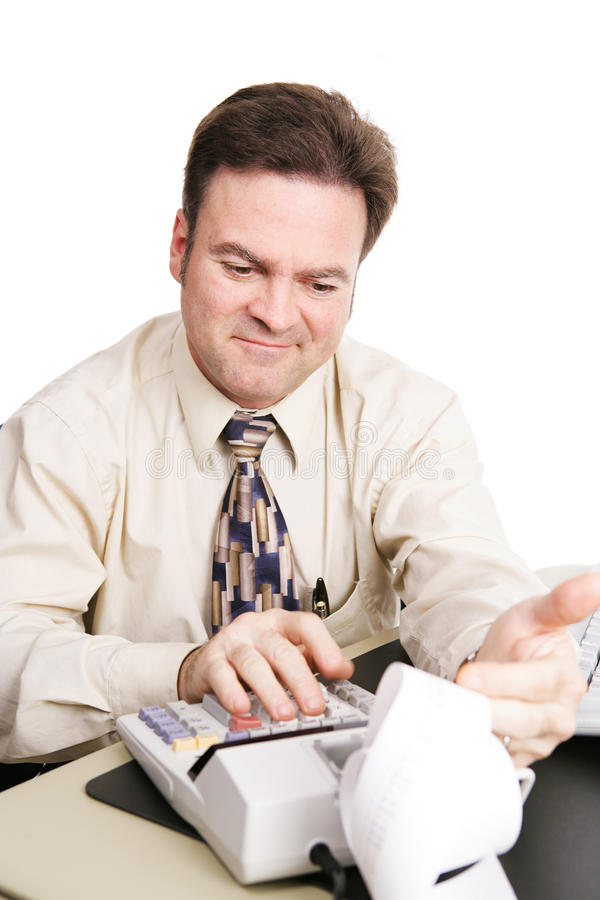 Accountant Satisfied. Accountant looking over the numbers and smiling with satisfaction. White background royalty free stock image