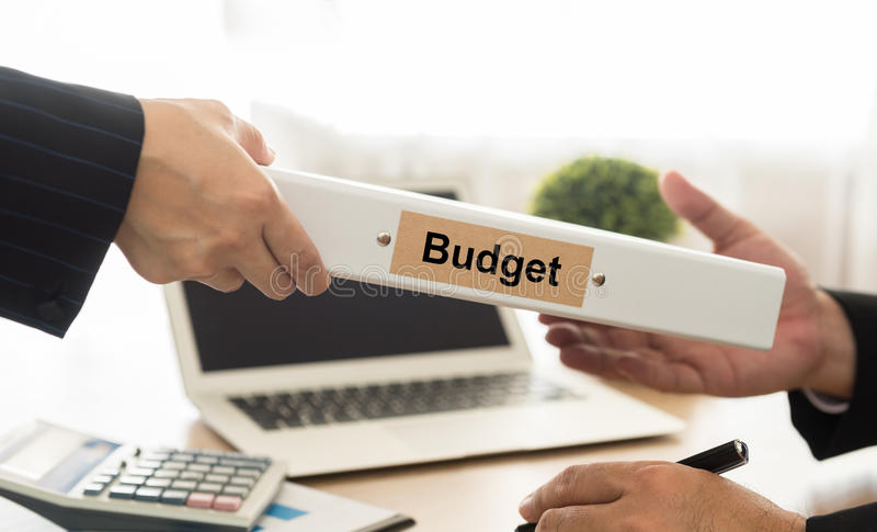 Accountant sends file budgets. Of the Company to executives stock photography