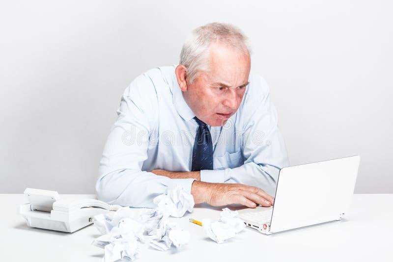 Accountant senior man. Working with laptop stock photo