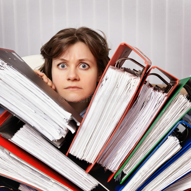 Accountant swamped with financial documents royalty free stock images