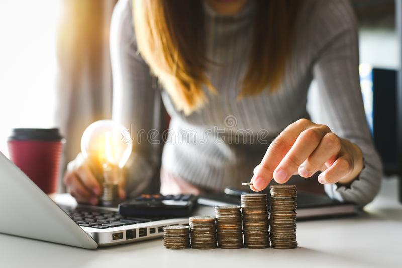 Accountant working on desk in office using calculator and smartphone to calculate budget. royalty free stock images