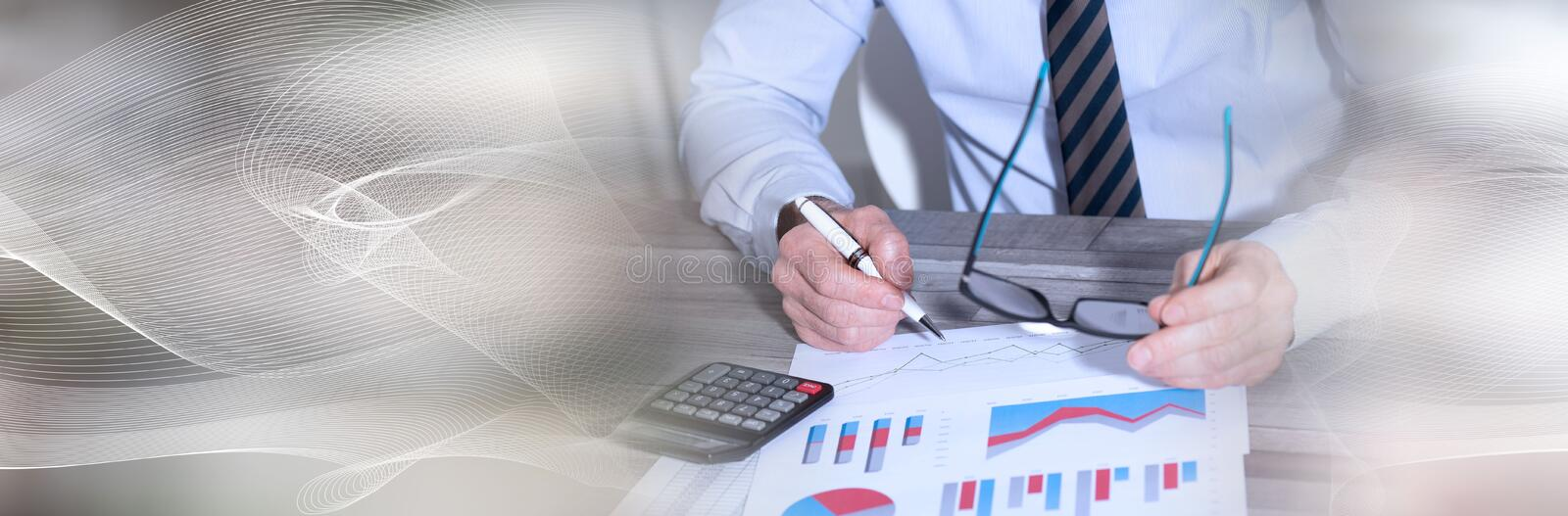 Accountant working on financial documents. panoramic banner. Accountant working on financial documents and using a calculator. panoramic banner royalty free stock photography