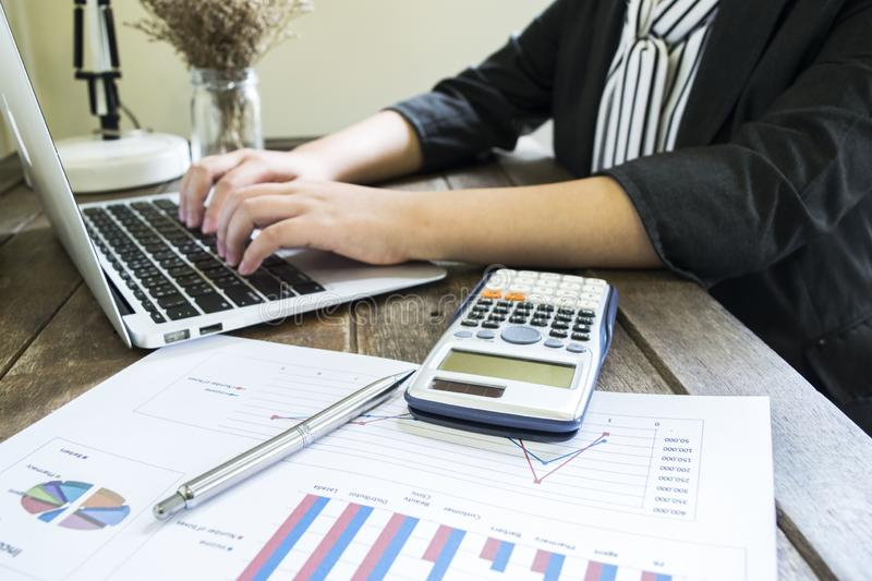 Accountants are examining the company`s finances to prepare business. Development plans for East Asia stock photography
