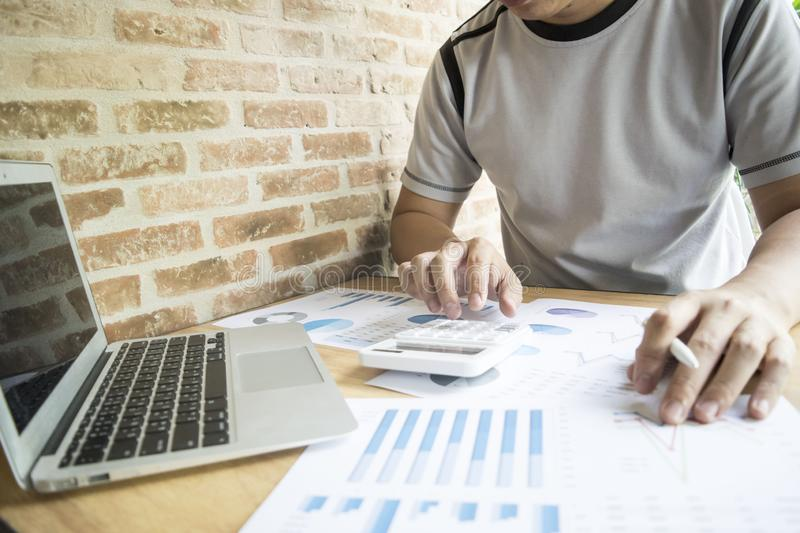 Accountants are examining the company`s finances to prepare business development plans for East Asia. Accountants are examining the company`s finances to stock image