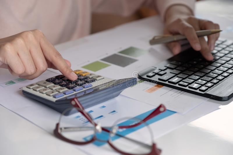 Accountants work analyzing financial reports on a laptop at his office, business analytics concept royalty free stock images