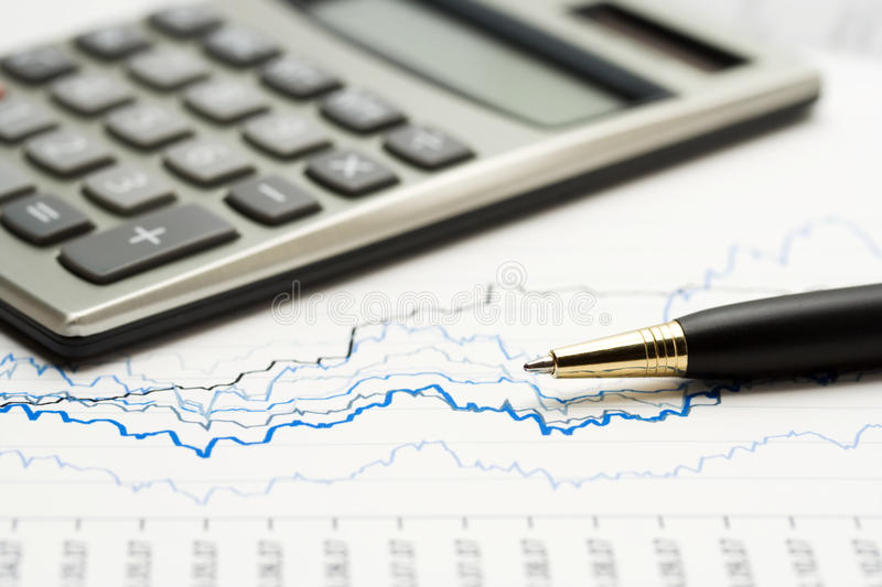 Accounting. Stock market graphs and financial analysis royalty free stock image