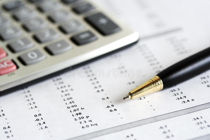 Accounting. Calculator, pen and financial balance royalty free stock photos