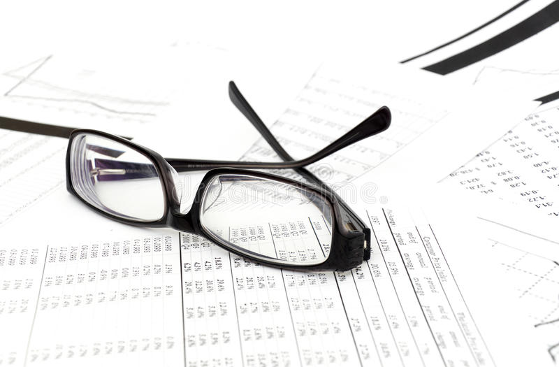Accounting. Black glasses lies on stack document royalty free stock photos