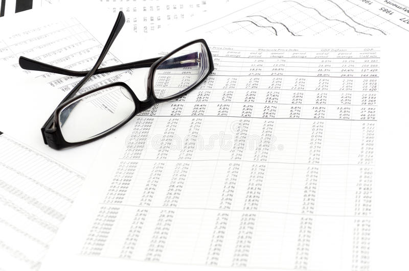 Accounting. Black glasses lies on stack document stock photography