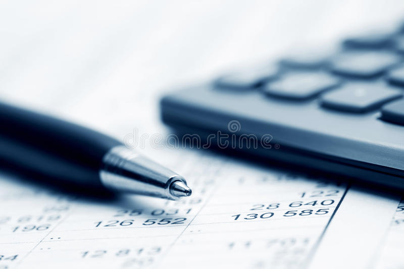 Financial accounting. Close up of calculator and financial reports analysis royalty free stock image