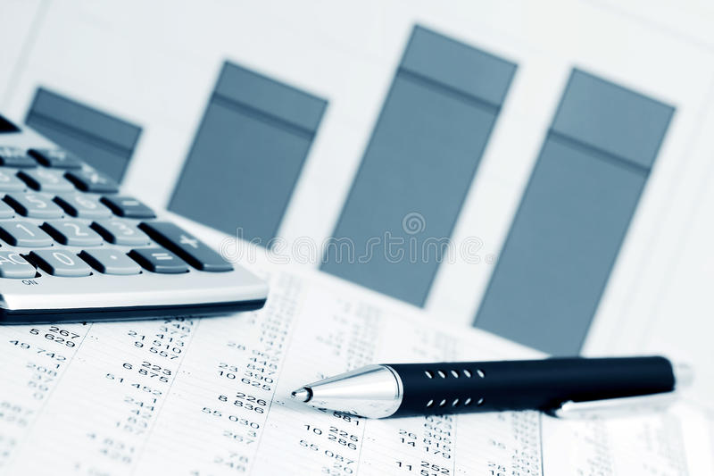 Accounting. Financial analysis and stock market graphs and charts royalty free stock photo