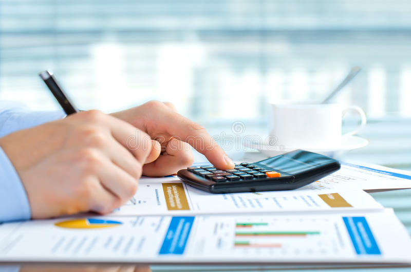 Accounting. Office supplies in the composition laid out on the table stock photos