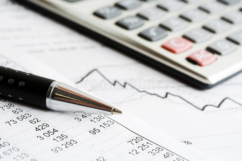 Accounting. Financial analysis and stock market graphs and charts royalty free stock photos