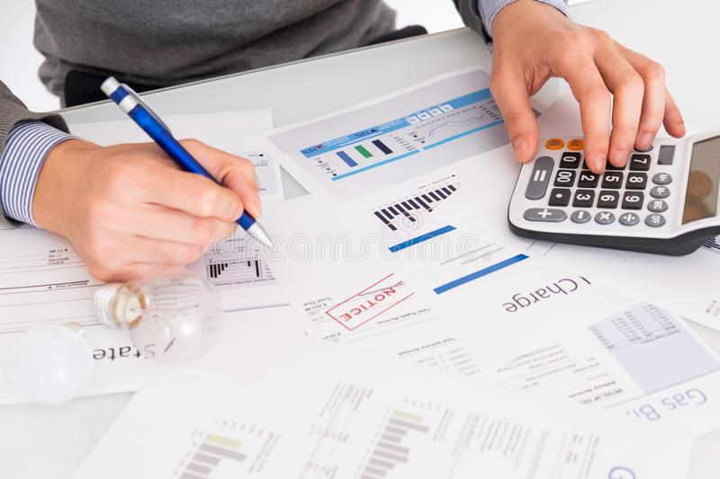Calculating energy efficiency and energy bill papers royalty free stock image