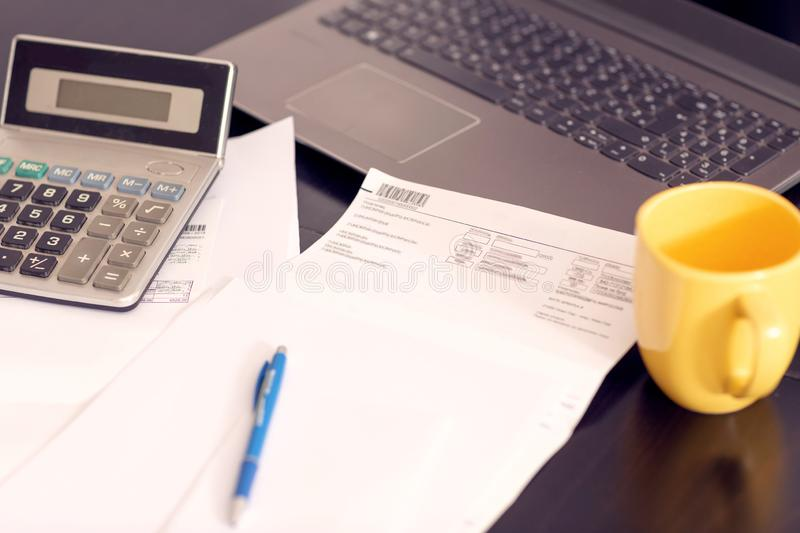 Accounting bill paper forms on the table- Paid in full. Top view stock images