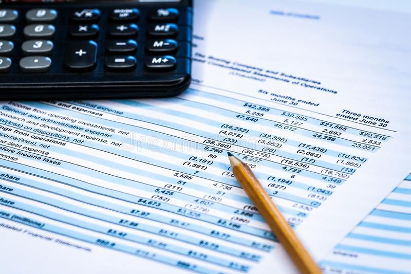 Accounting business. Calculator with accounting report and financial statement stock photos