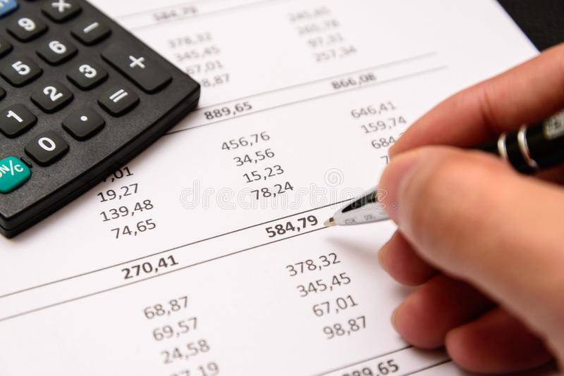 Accounting equipment in use. stock photo
