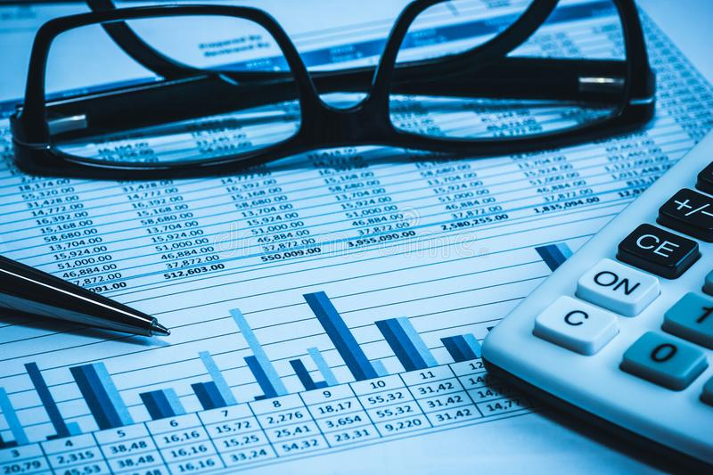 Accounting financial bank banking account stock spreadsheet data for accountant with glasses pen and calculator royalty free stock photos