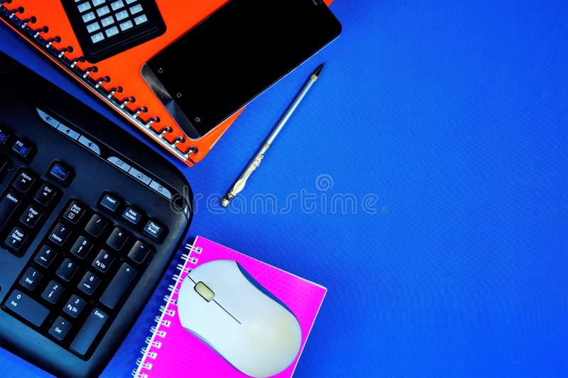 Accounting office Desk background blue, with the necessary accessories, calculation of taxes, expenses and income. Office work pen stock photography