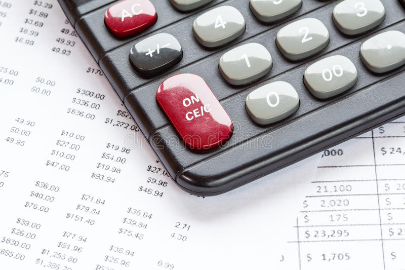 Accounting in process. With calculator and financial charts royalty free stock image