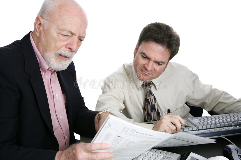 Accounting Series- Confusing Tax Forms. A senior man confused the his tax forms and seeking advice from an accountant. Isolated on white stock image