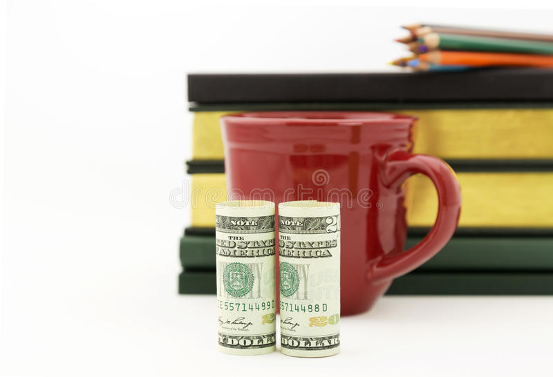 Accounting success seen in American currency, red mug, pencils, royalty free stock image