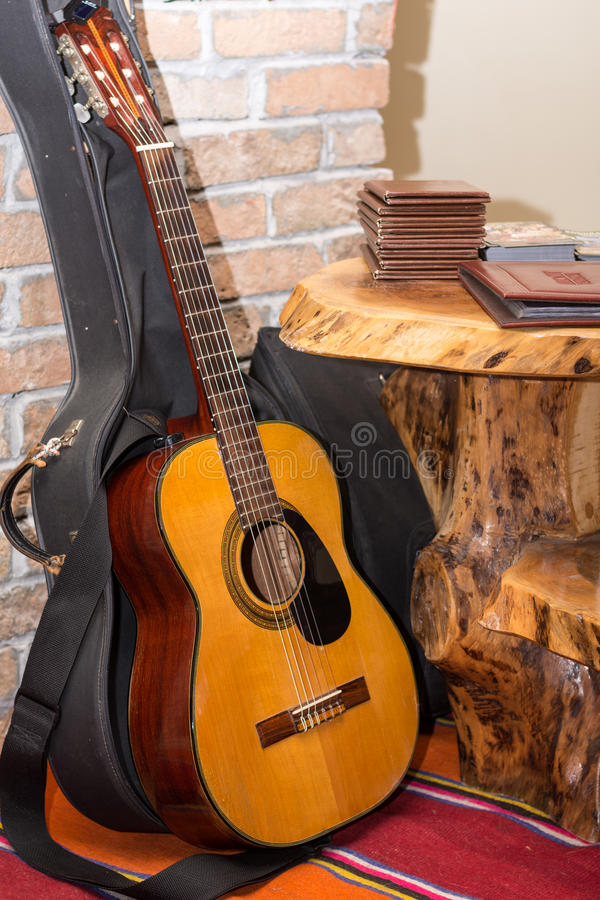 Accoustic guitar by the brick wall.  stock photos