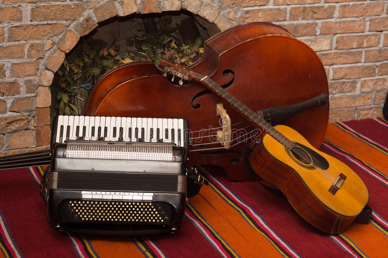Accoustic guitar and contrabass with accordion.  royalty free stock photo