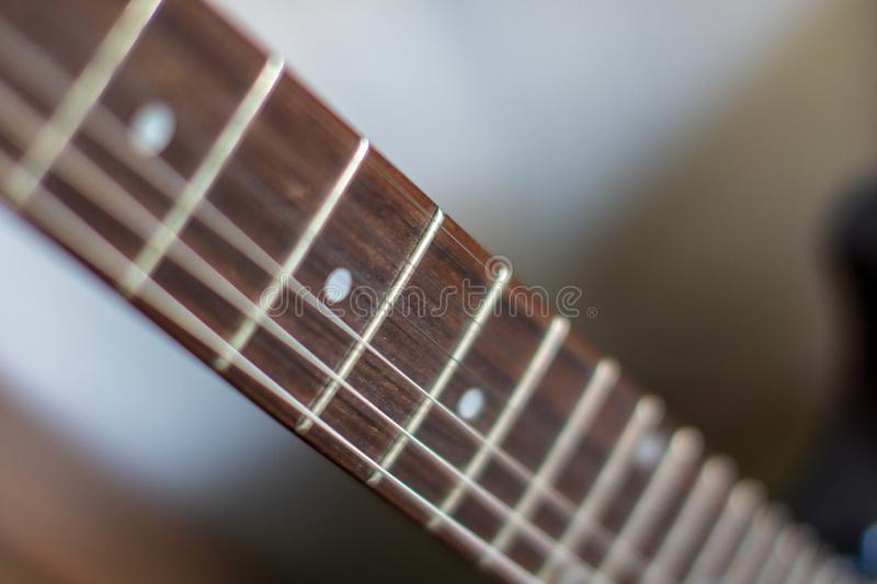 Accoustic guitar strings with male hand playing. Chords stock image