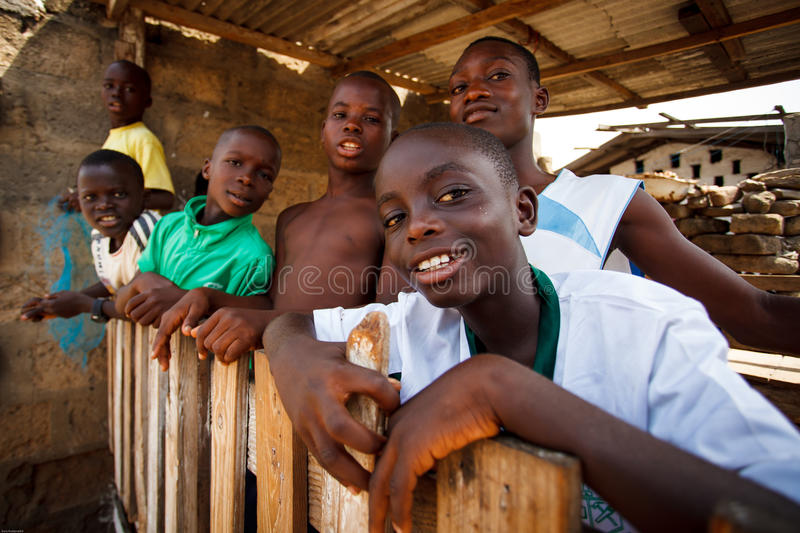 ACCRA, GHANA � MARCH 18: Unidentified african boys greeting to t. Ourists with smiling faces on March 18, 2014 in Teshie community, Accra, Ghana, Teshie is stock images