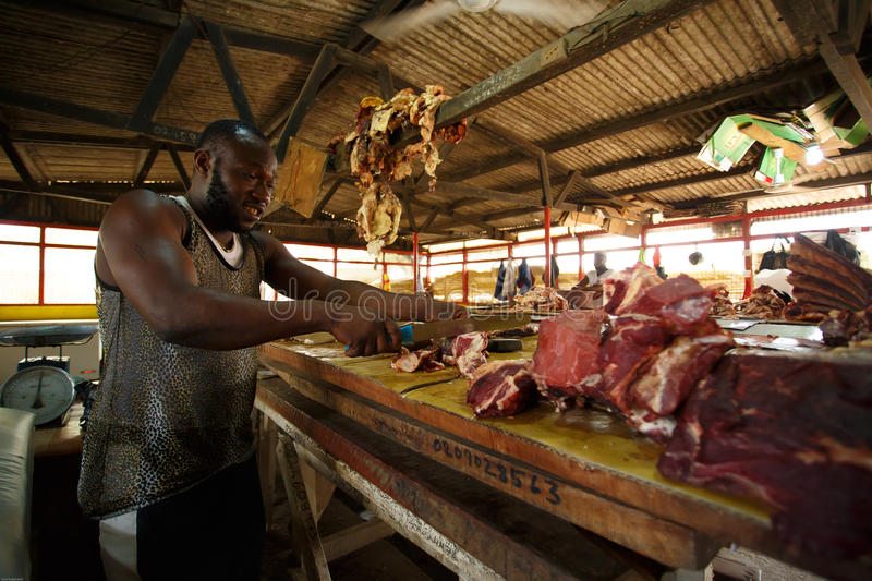 ACCRA, GHANA � MARCH 18: Unidentified Ghanaian butcher doing hi. S job in Nima market on March 18, 2014 in Nima community, Accra, Ghana. Nima in one of the stock photography