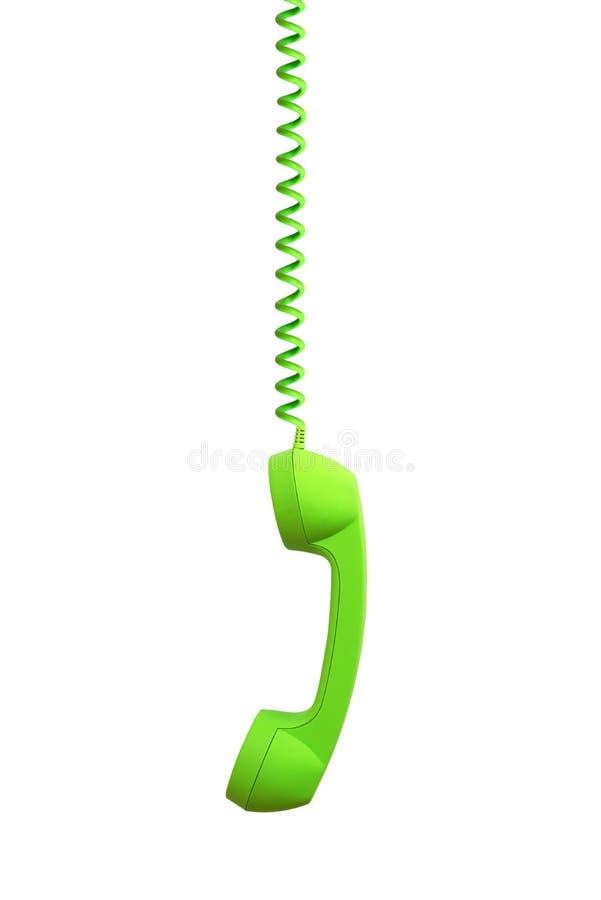 Accrocher vert de récepteur de téléphone, d'isolement sur le blanc photographie stock