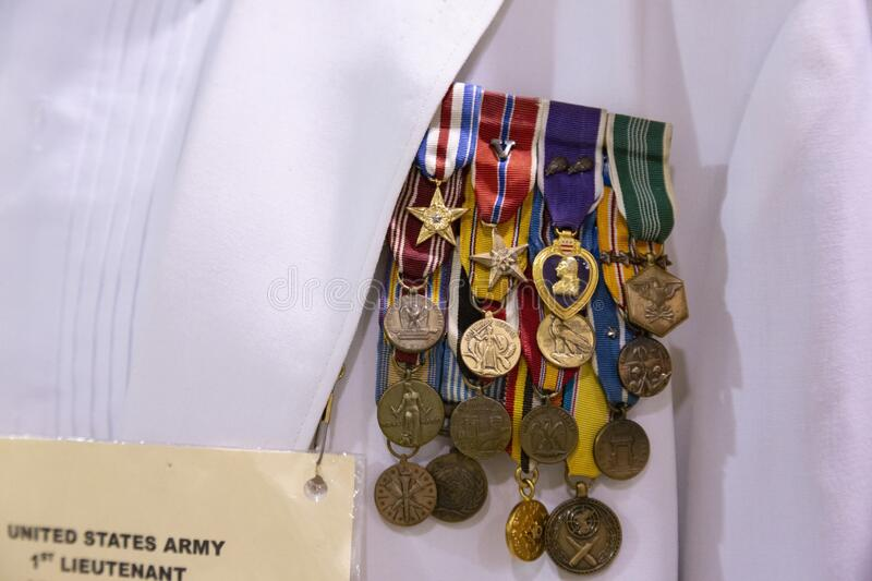 Accumulation of United States Army medals. Salem, Oregon / USA - July 12, 2018: Close view of vintage United States Marine Officer dress uniform with stock photo