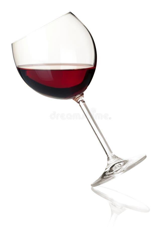 Accumulazione del vino - vino rosso in vetro di caduta immagini stock