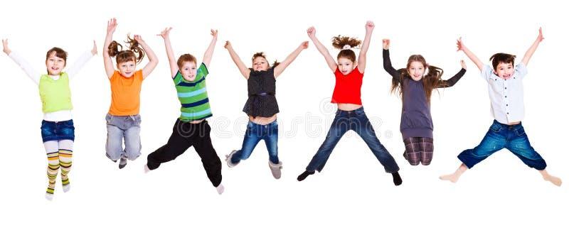 Accumulazione di salto dei bambini fotografia stock libera da diritti